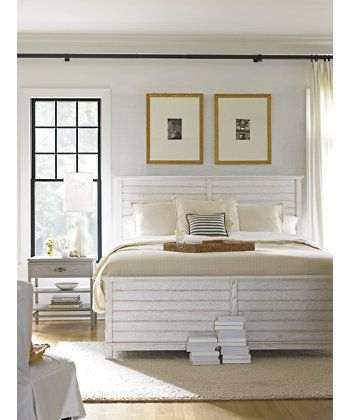 interesting curtain rod placement above bed Young America line