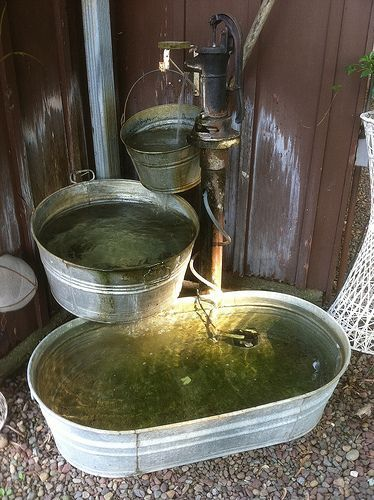 Galvanized fountain something like this for beside the for Build outdoor rock water fountains