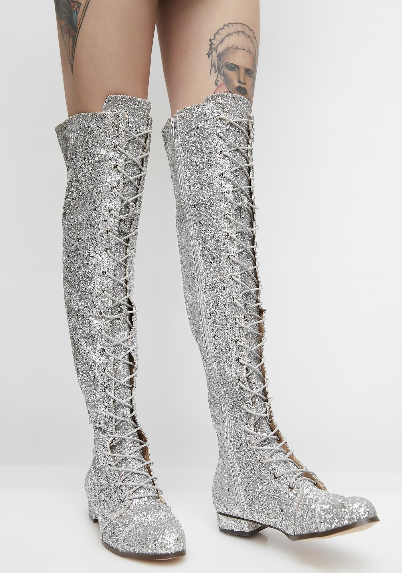 91a5f53a74f8 Glitter Take  Em Down Lace-Up Boots cuz you know you re deadly. These  sparkly silver knee-high boots have lace-ups on the front and inside zipper  closures.