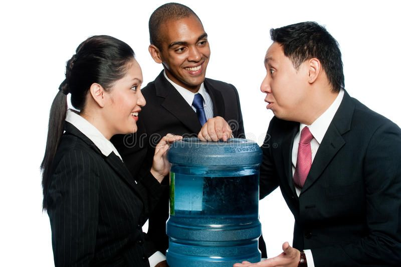 Office Gossip Three Colleagues Stand Around A Water Cooler