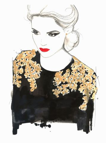 Glamorous woman wearing ornate black and gold blouse