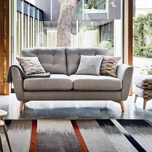 Contemporary The Gela sofa is a contemporary sofa with a wraparound curved arm that hugs the back cushions The fibre back cushions and deep foam and fibre seats offer a Modern - New 3 cushion sofa New