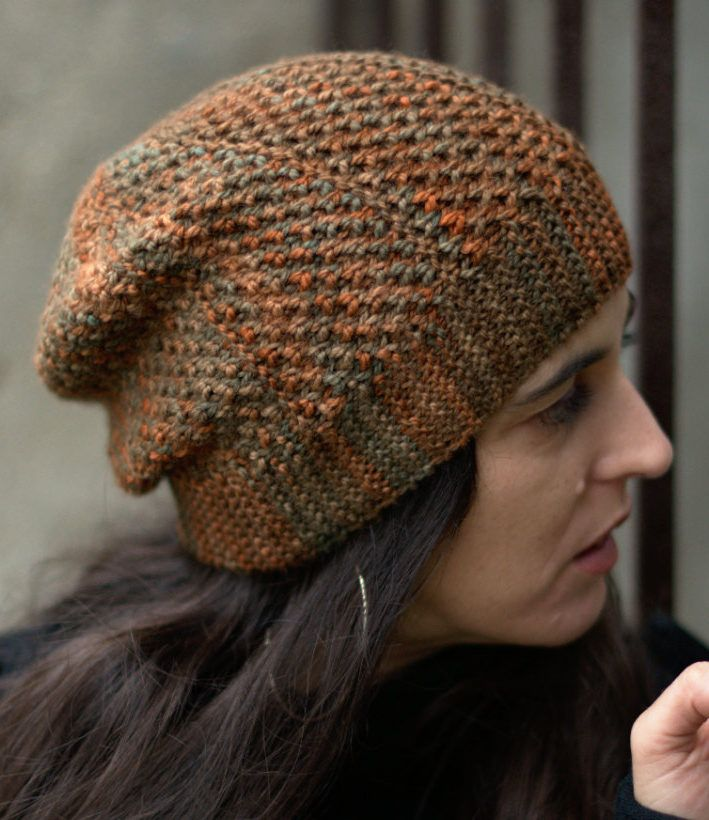 a78c554ac8c Knitting Pattern for Muratura Sideways Slouchy Hat - Slouchy beanie knit  flat on straight needles with a textured stitch that showcases multicolored  yarn.