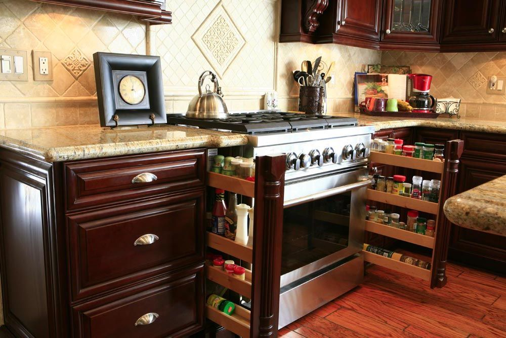 Spice rack pullouts built in next to stove