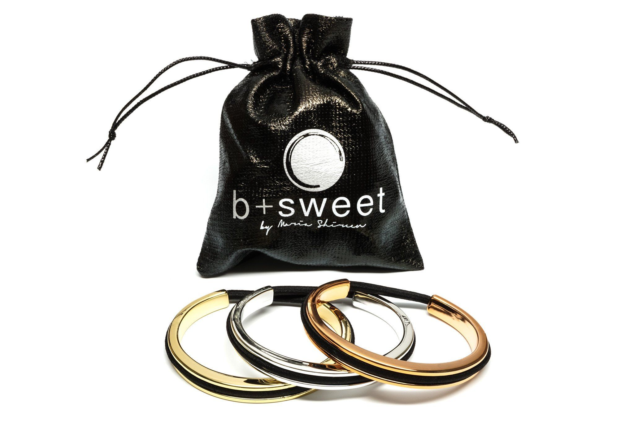 Hair tie bracelet by Maria Shireen in BPA free plastic with metallic plated finish