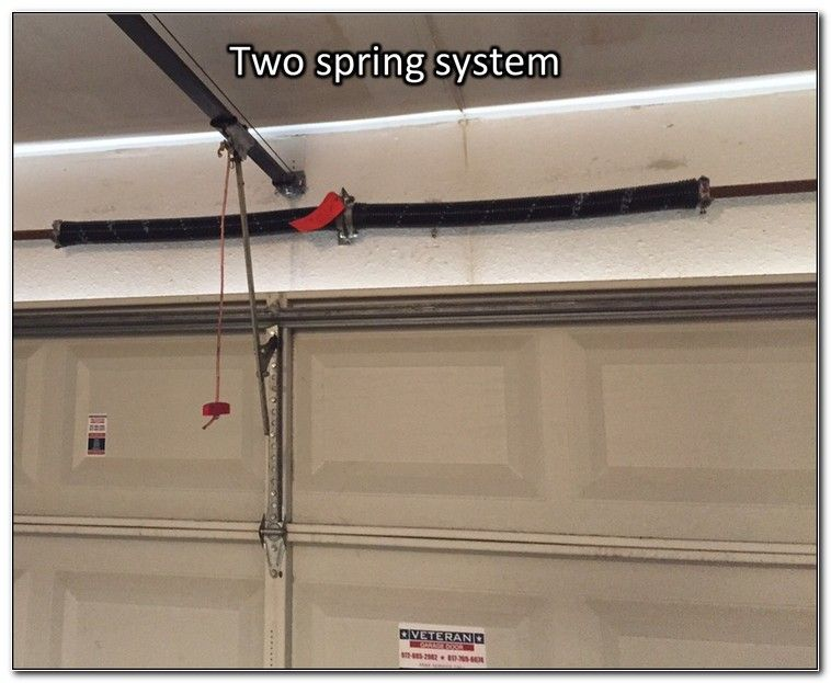 How Much Does A Garage Door Torsion Spring Cost Garage Door Springs Garage Door Spring Adjustment Garage Door Torsion Spring