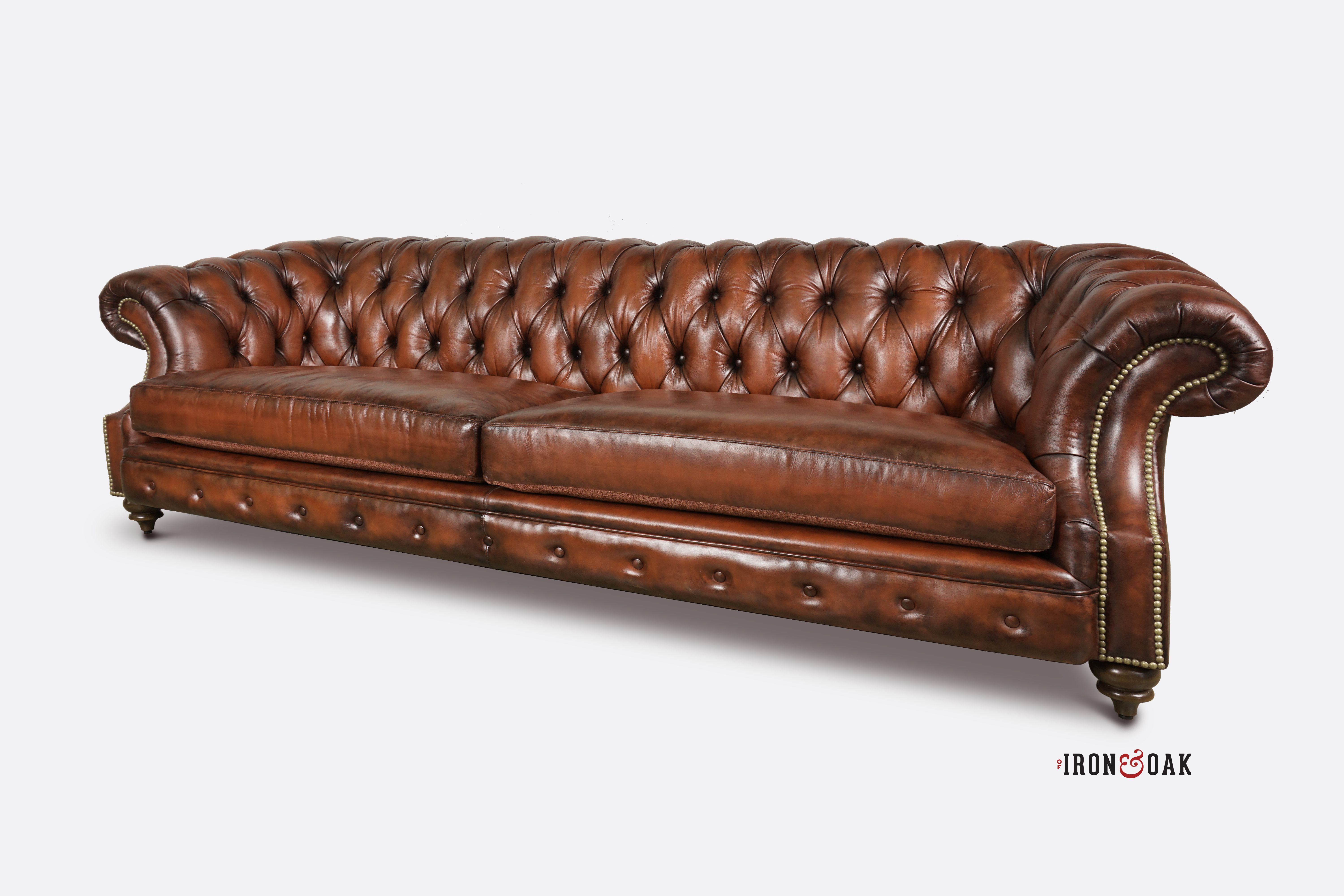Chesterfield sofa expertly upholstered in coganac leather hand stained to perfection the langston features a sloped scoop arm american made furniture