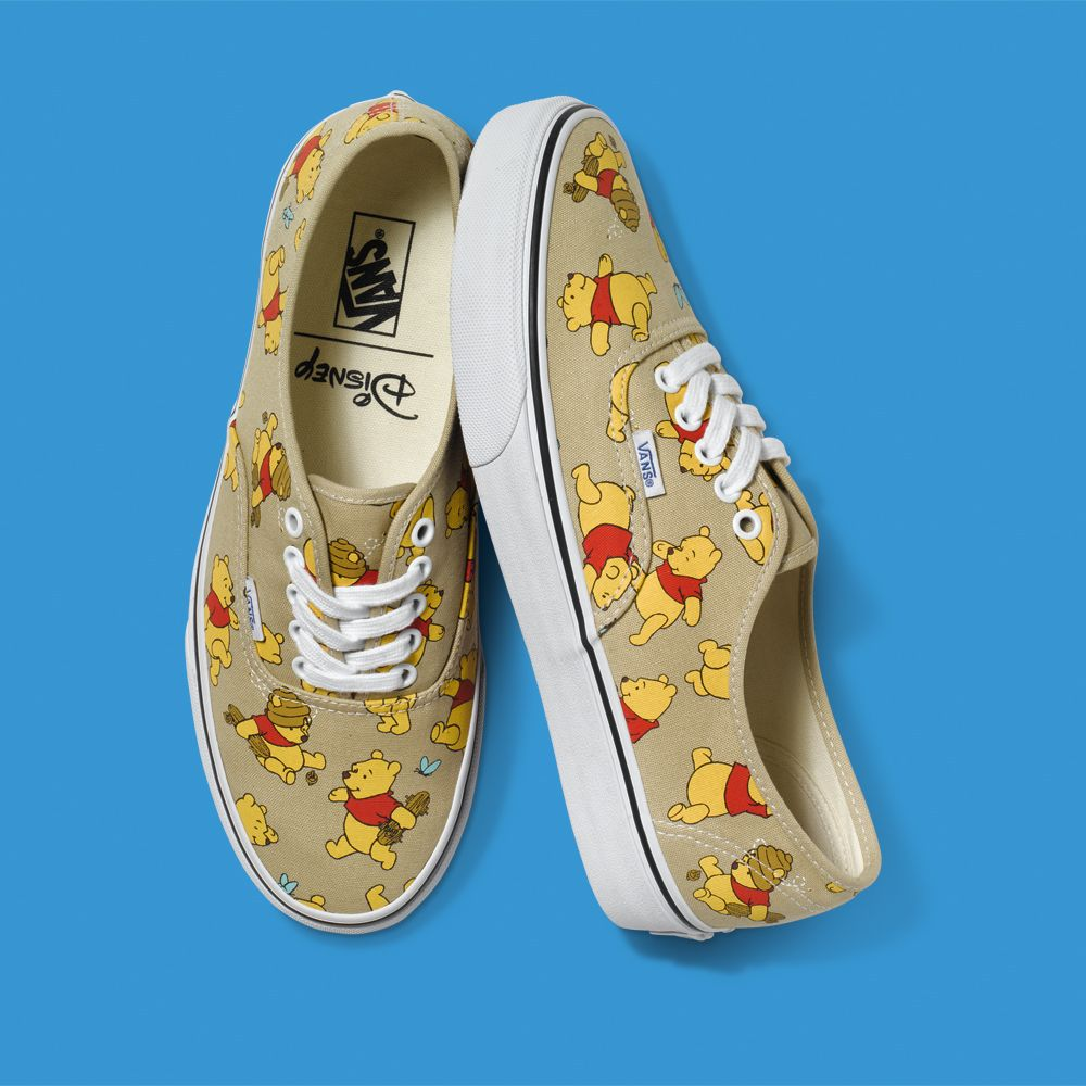 c337f0d641dd The Disney and Vans Young at Heart Collection is Now Available! -- reminds  me of my pooh overalls I had as a kid ♡