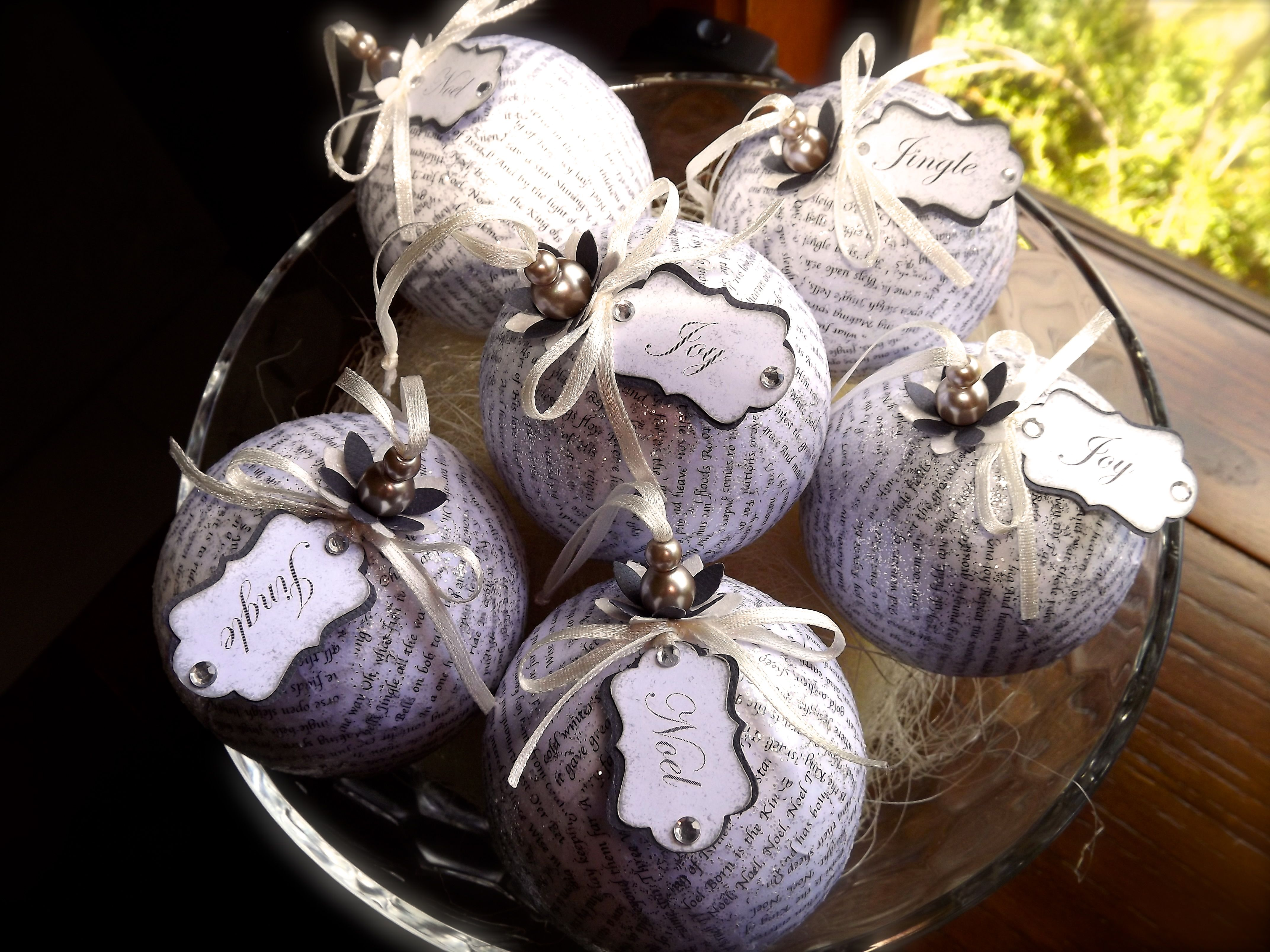 Christmas decoration ornament featuring decoupaged Christmas carol