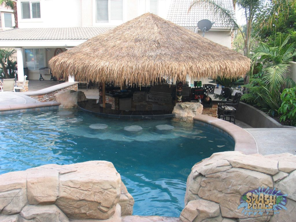 Awesome swim up bar with tiki style cabana for Custom pool cabanas