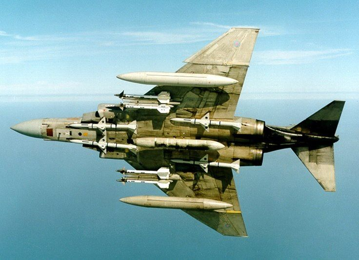 f 4c d phantom ii armed with a centerline gun pod four aim