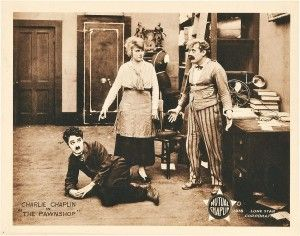 The Pawnshop (Mutual, 1916) with Charlie Chaplin, Edna Purviance, and John Rand. Lobby Card Source