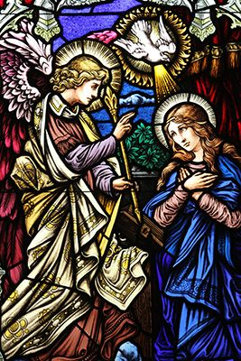 the annunciation is one of five stained glass windows in