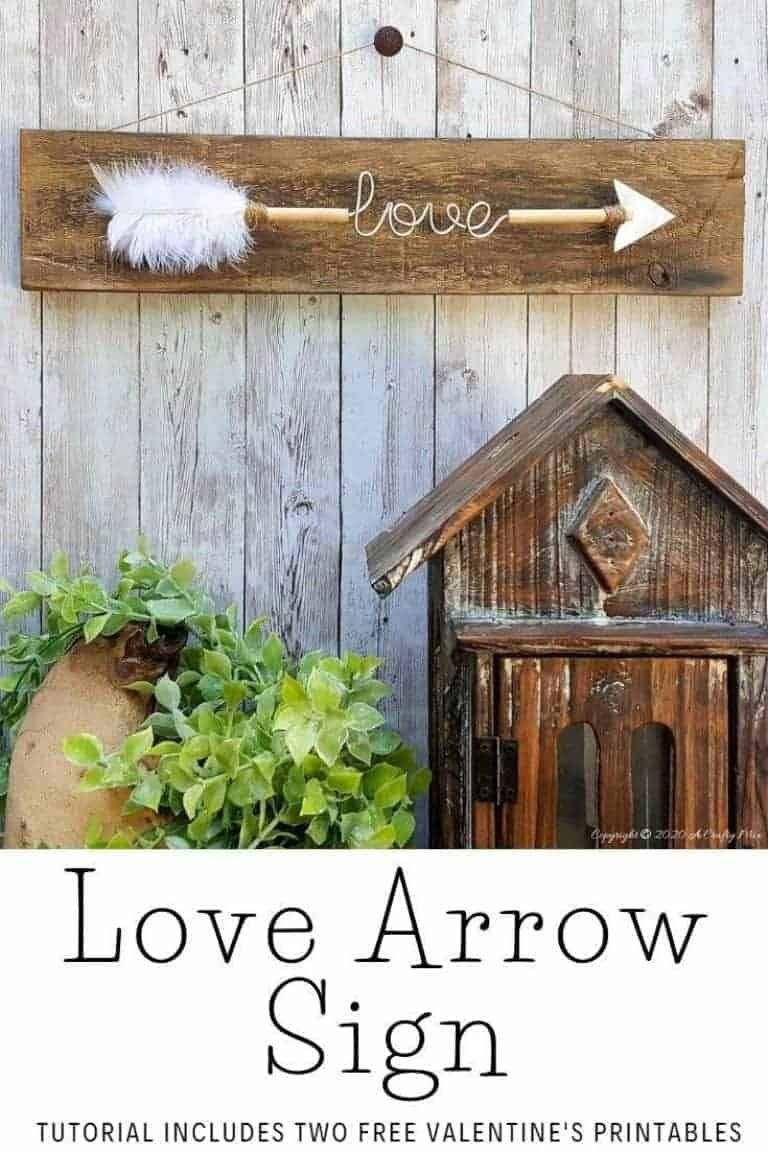Make a gorgeous LOVE arrow sign to add to your gallery wall. It's fun, easy and you can customize the wire words to fit your unique style. Includes two free printables #gallerywall #acraftymix #valentinesday #lovearrow #bohodecor #lovedecor #DIYArrowdecor #ArrowPrintable #arrowDIY #arrowcrafts #DIYWirewords