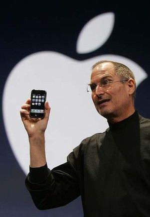 Steve Jobs Holds Up The First IPhone During His Keynote Address At MacWorld Conference Expo In San Francisco 2007