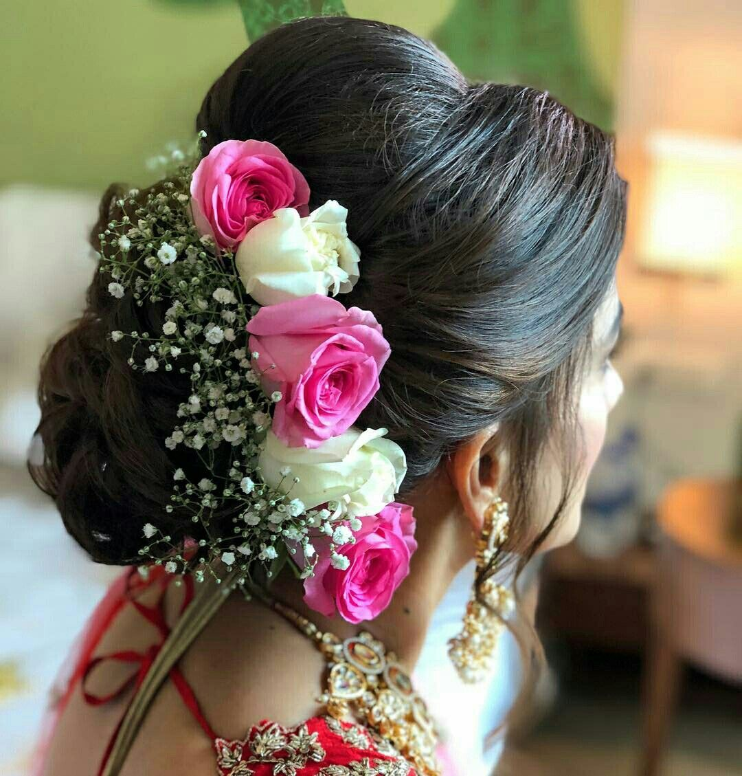What A Beautiful Large Low Bun With Real Flower Gajra Care However Should Be Taken Before Adop Loose Hairstyles Engagement Hairstyles Indian Bridal Hairstyles