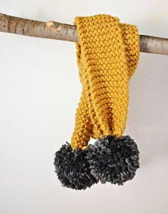 Photo of Knitted Pom Pom Scarf