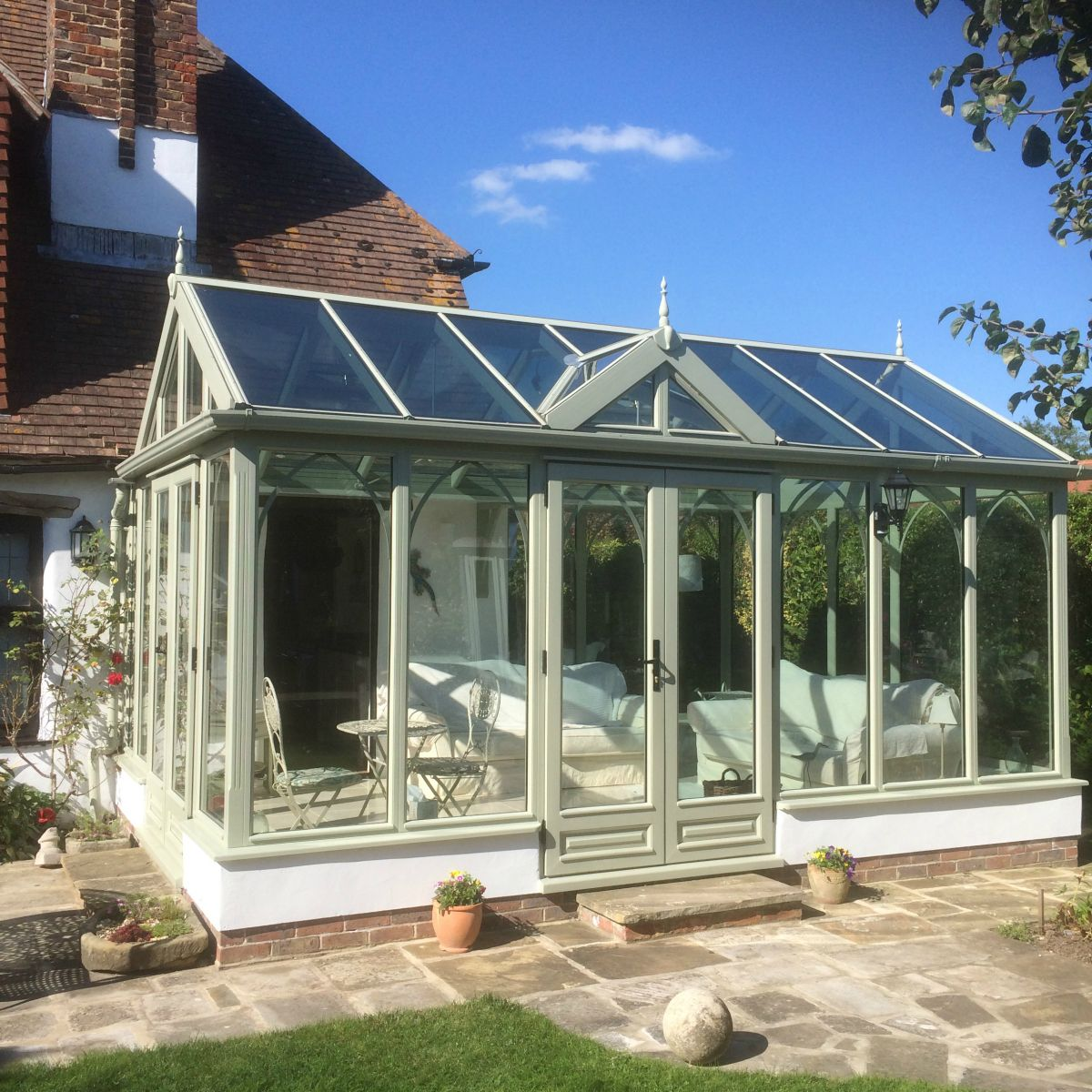 New Conservatory Painted In Heritage Green With Self Cleaning Soft Coated Aqua Blue High Performance Sol Glass Conservatory Roof Glass Conservatory Orangery