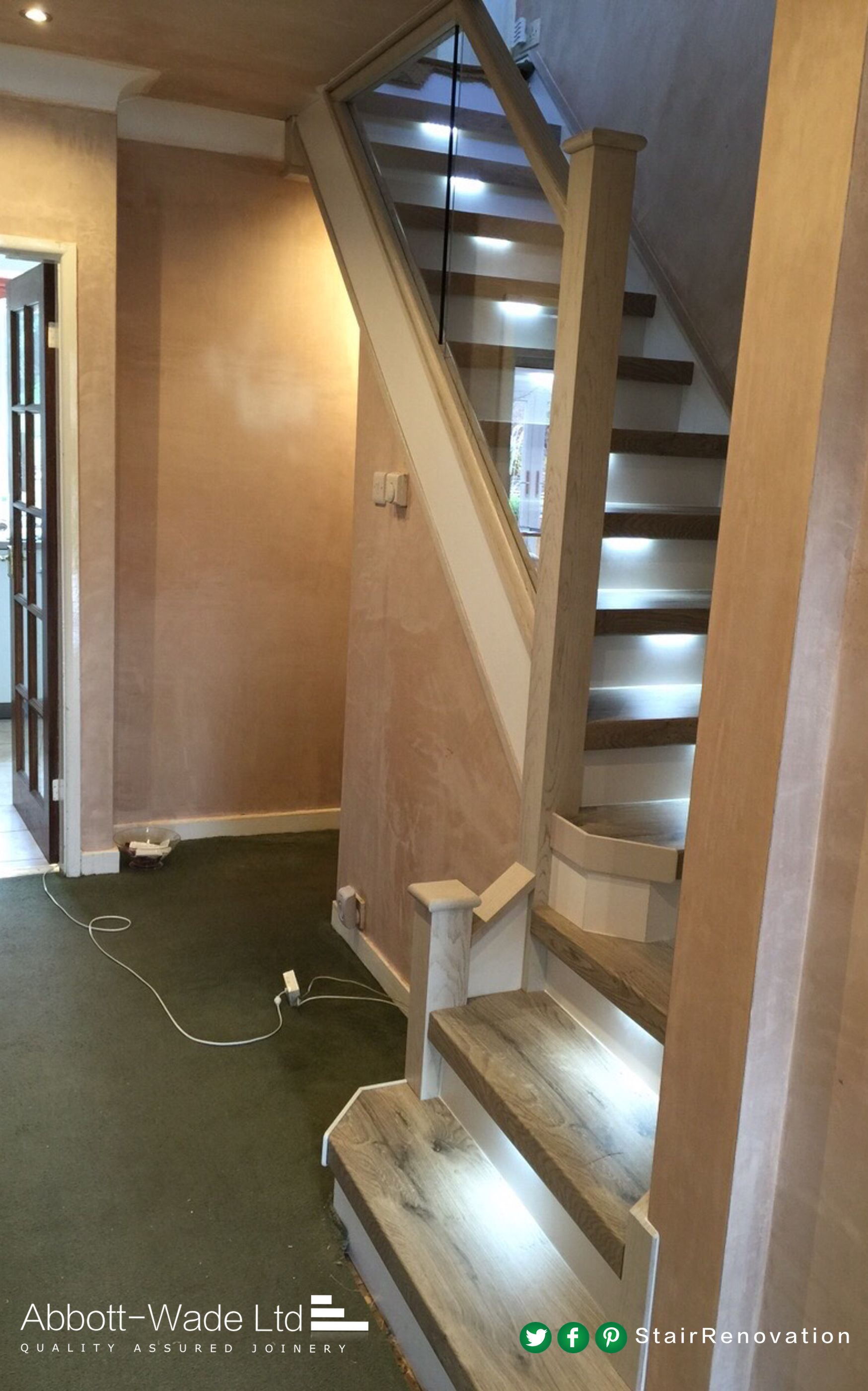 Staircase in Arlington Oak with white riser built in lights & glass balustrade