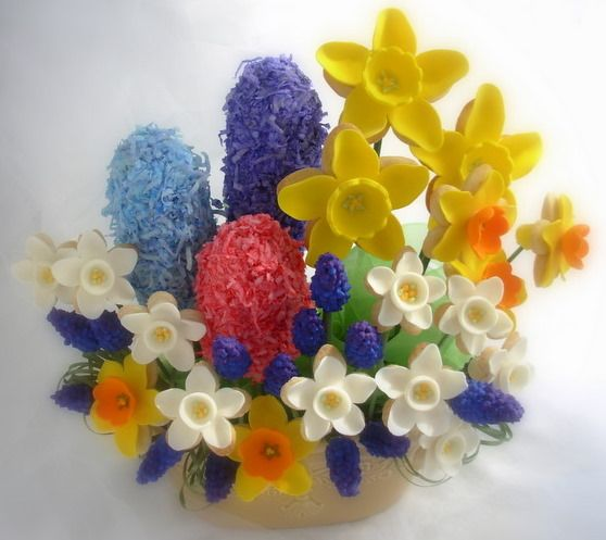 Gorgeous site showing how to make edible cookie flowers! I don't know that I'd have the time or patience, but these are amazing. Think Spring shower. . .