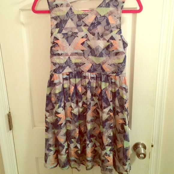 Vera Wang printed lace dress High neckline with open back dress. Very fun print & colors. New with tags. Size M, but definitely runs big very stretchy material. Vera Wang Dresses Backless