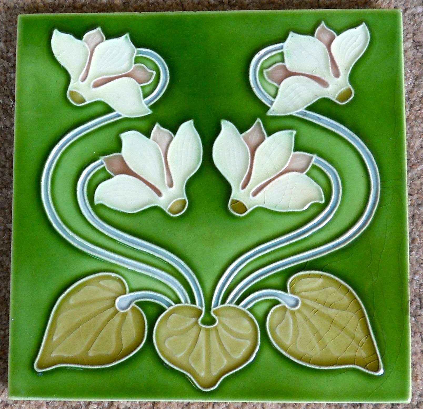Very good colours glazes are used with this design from Gibbons Hinton Co c1906/9 see tile reference 269 in the book Art Nouveau Tiles with Style, to see another wonderful colour way.