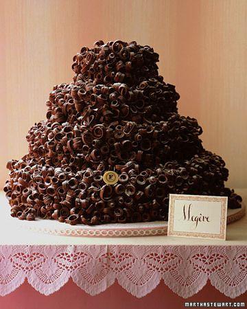 A vanilla meringue cake covered in chocolate curls