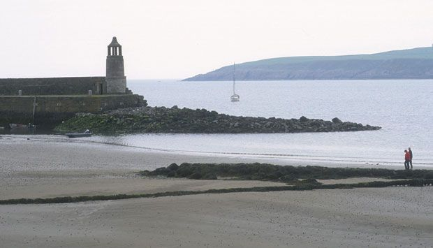 the sandy beach at Port Logan at low tide