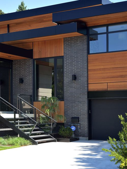 gray brick black trim cedar siding  home sweet