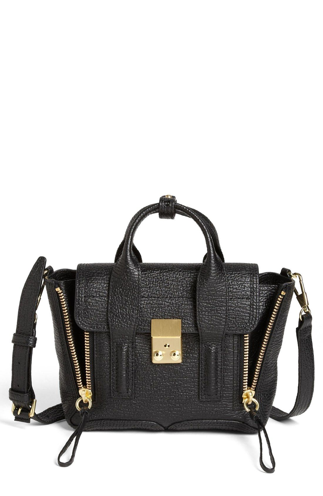 Richly textured leather, gleaming gold hardware and a compact satchel style  create a fabulous on trend look.