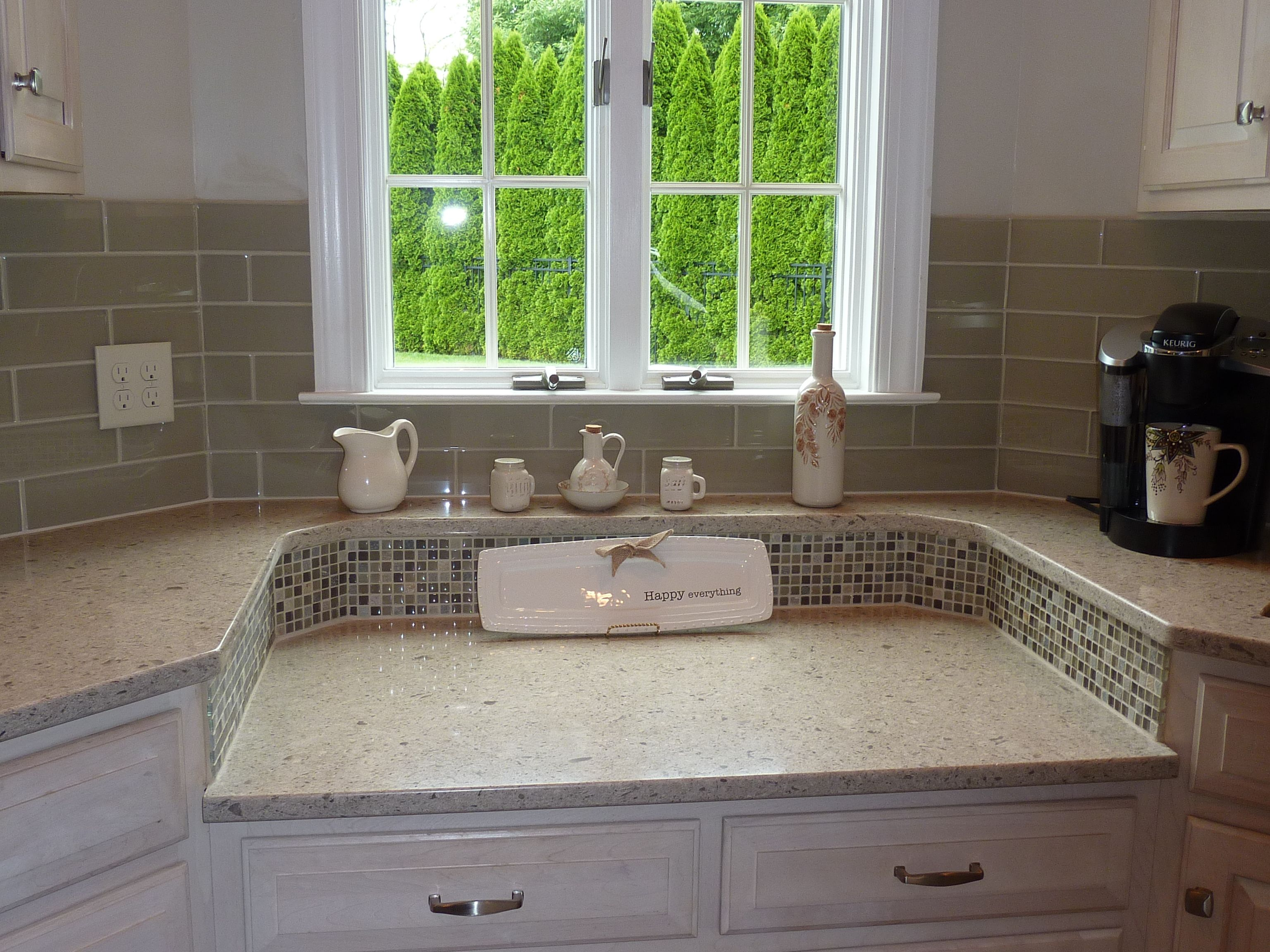 Cambria Darlington Quartz counters Bliss stone glass mosaics and Bliss Element Earth glass