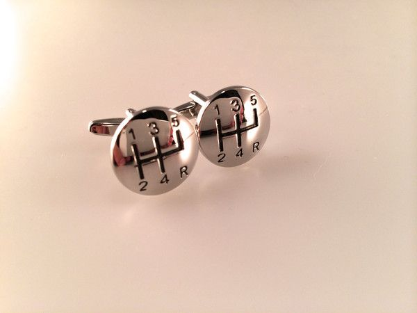 These cuff links feature a very realistic gear shift - very high end and makes a great gift for the man in your life or for your wedding party, groomsman, Father's Day - you see perfect for any occasion!    Comes in a gift box.    Ask about discounts for multiple items.