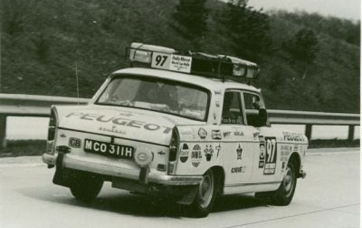 A speedy Peugeot 404, no:97, races along the auto routes of Europe. Driven by Ken Haskell, David Paull & Douglas Larson they failed to reach the finish.