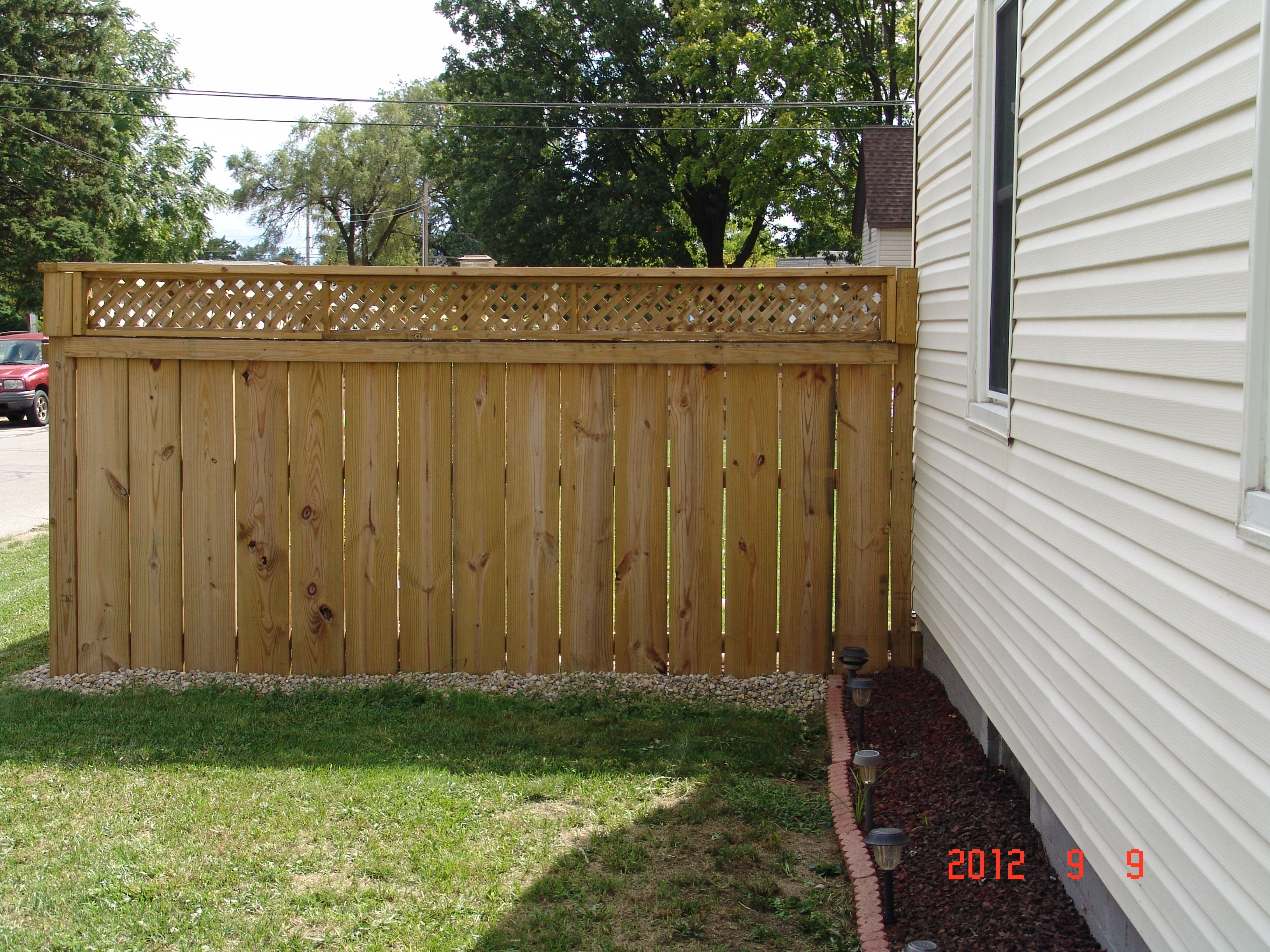 L side of custom built privacy fence reinforced with existing