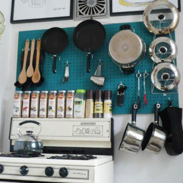 Pegboards rock! Look how much storage in such a tiny kitchen!