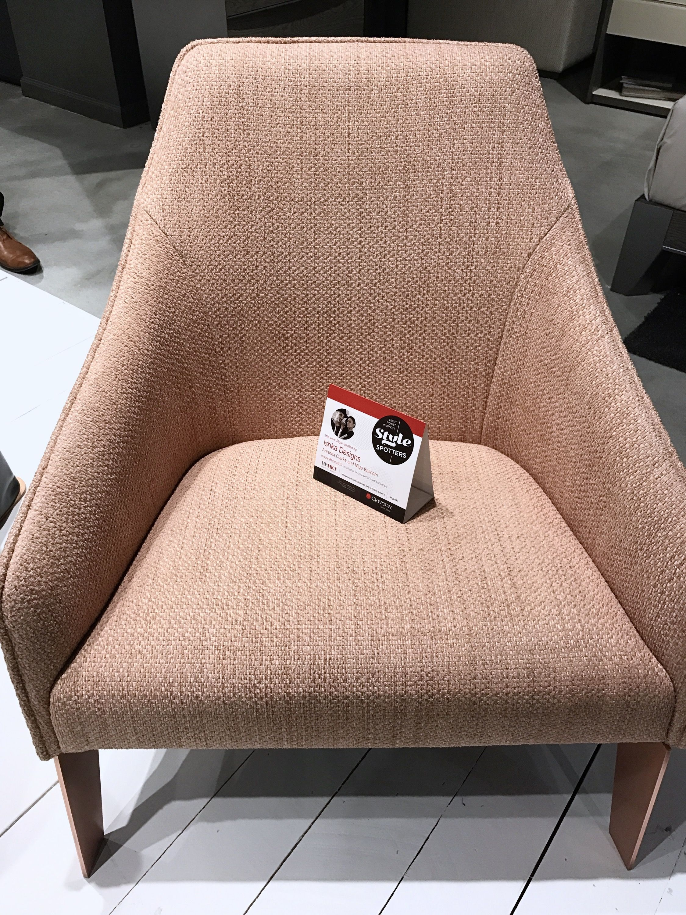 Rose gold skinny legs support a plush lounge chair by Canadian