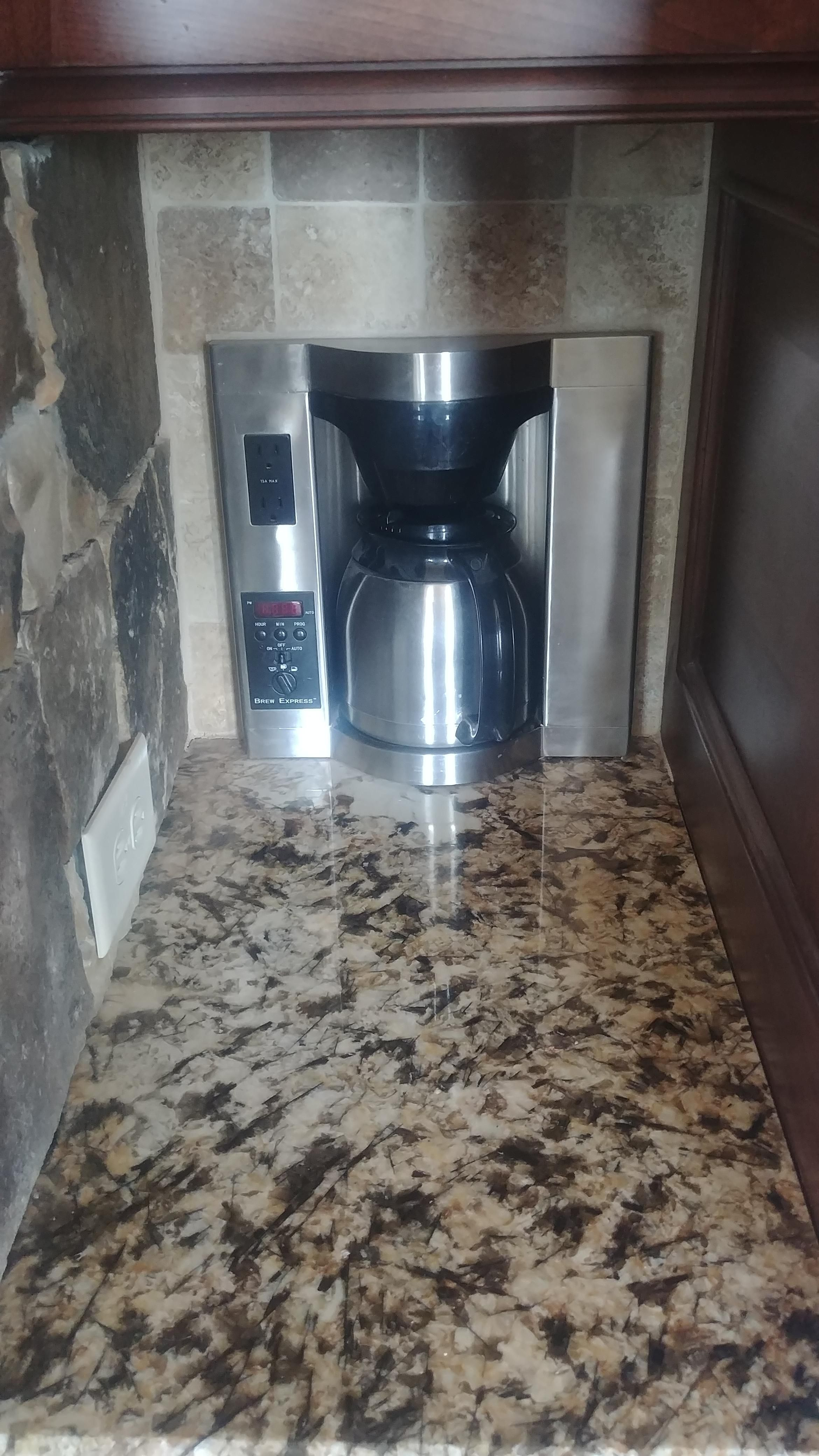 My aunt bought a new house that has a coffee maker built into the