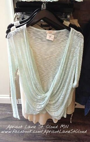 Another one of my favorites! Mint crossover top is perfect for the spring or a cooler night in the summer. These tops are very comfortable to wear. I would add a little necklace & wear with jeans. But it would look fab with a pair of white shorts. Give Apricot Lane St. Cloud a call at 320-774-1533 or find them on Facebook.  #ApricotLaneStCloud