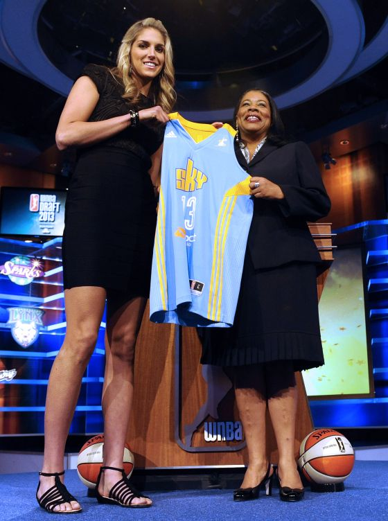 Delawares Elena Delle Donne holds up a Chicago Sky jersey with ...