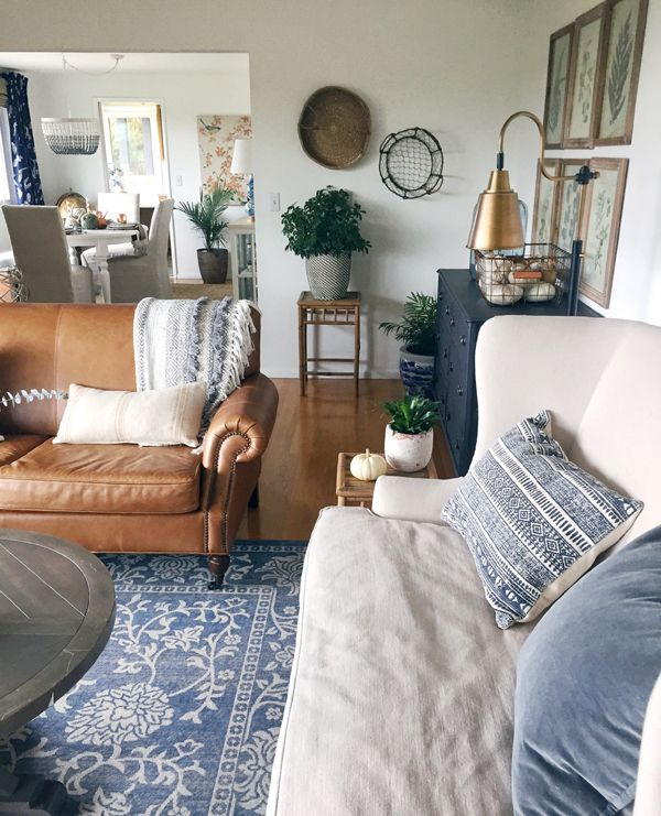 Blue sofa Cream Walls