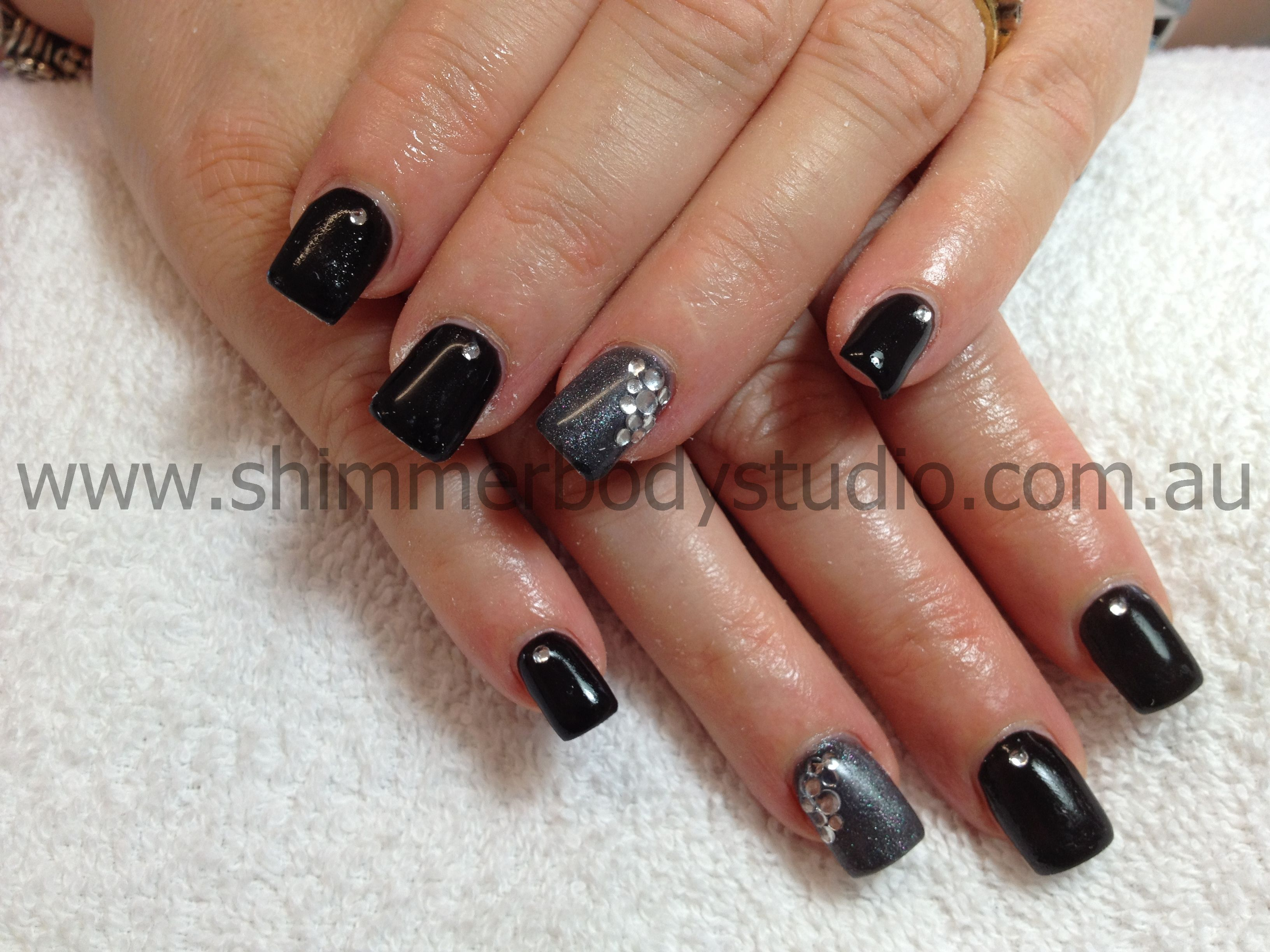 Gel nails, black and stainless steel nails, diamante cluster ...
