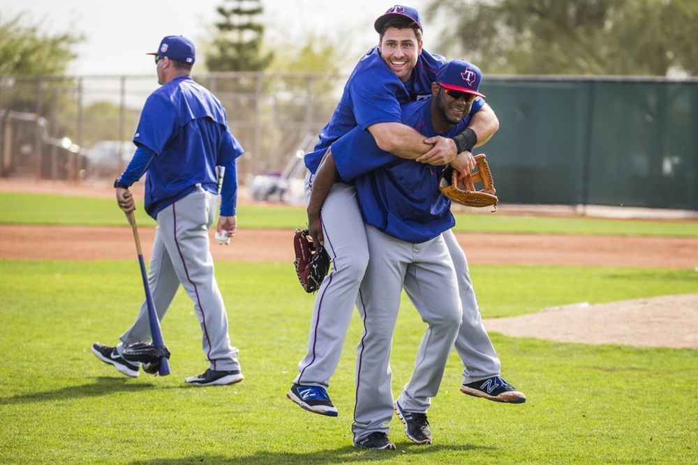 Texas Rangers third baseman Joey Gallo gets a piggyback ride off the field from infielder Hanser Alberto during a spring workout at the team's training facility on Wednesday, March 2, 2016, in Surprise, Ariz. (Smiley N. Pool/The Dallas Morning News)