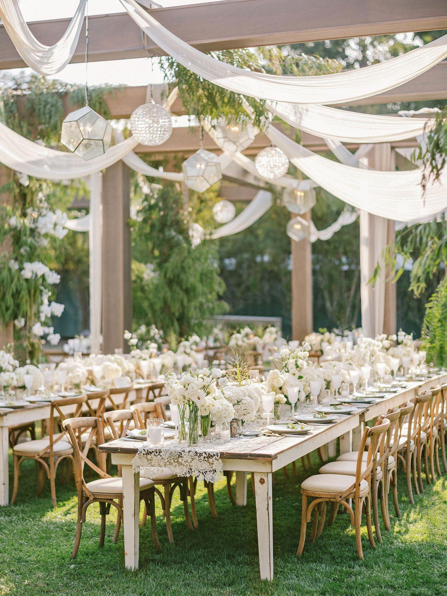 Pergolas Draped In Muslin Pepper Berry Feather Eucalyptus And White Bougainvillea Defined The Rece Wedding Pergola Gazebo Wedding Wedding Backyard Reception