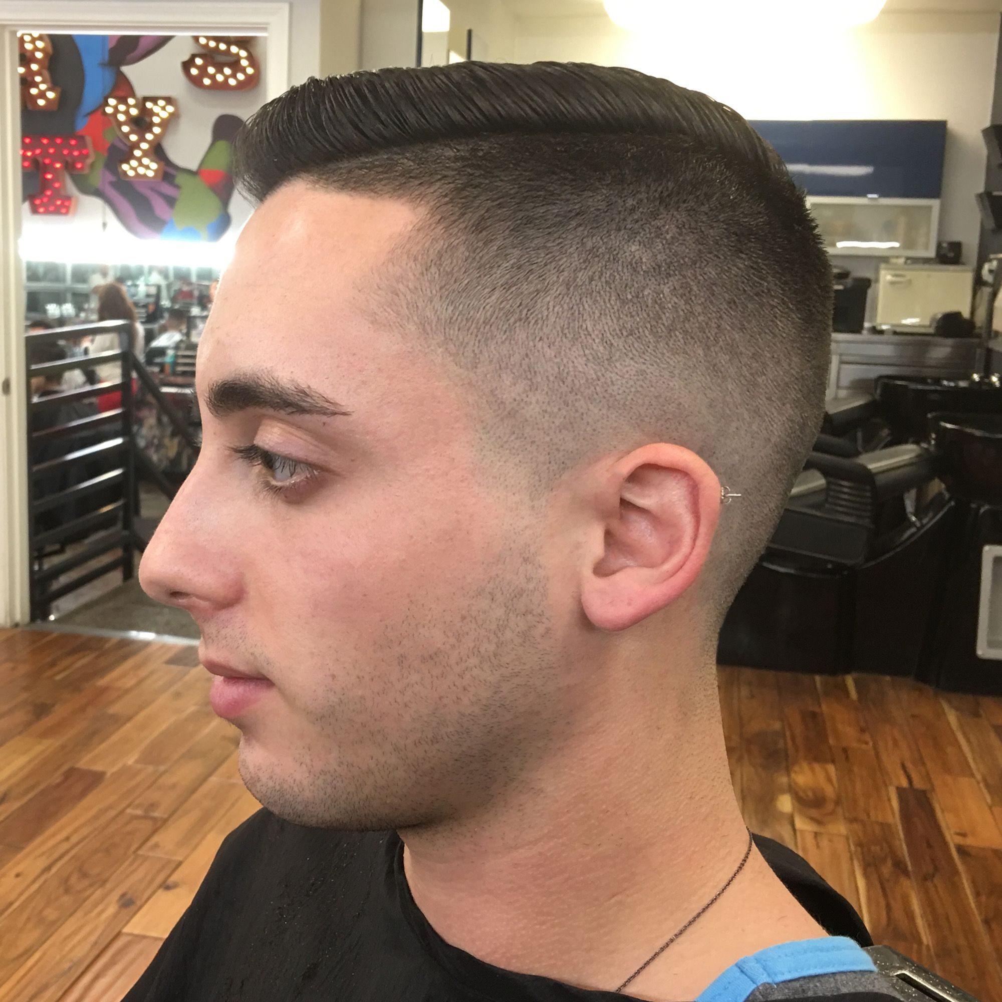 This medium skin fade was done with a razor about 1 3 the way up the