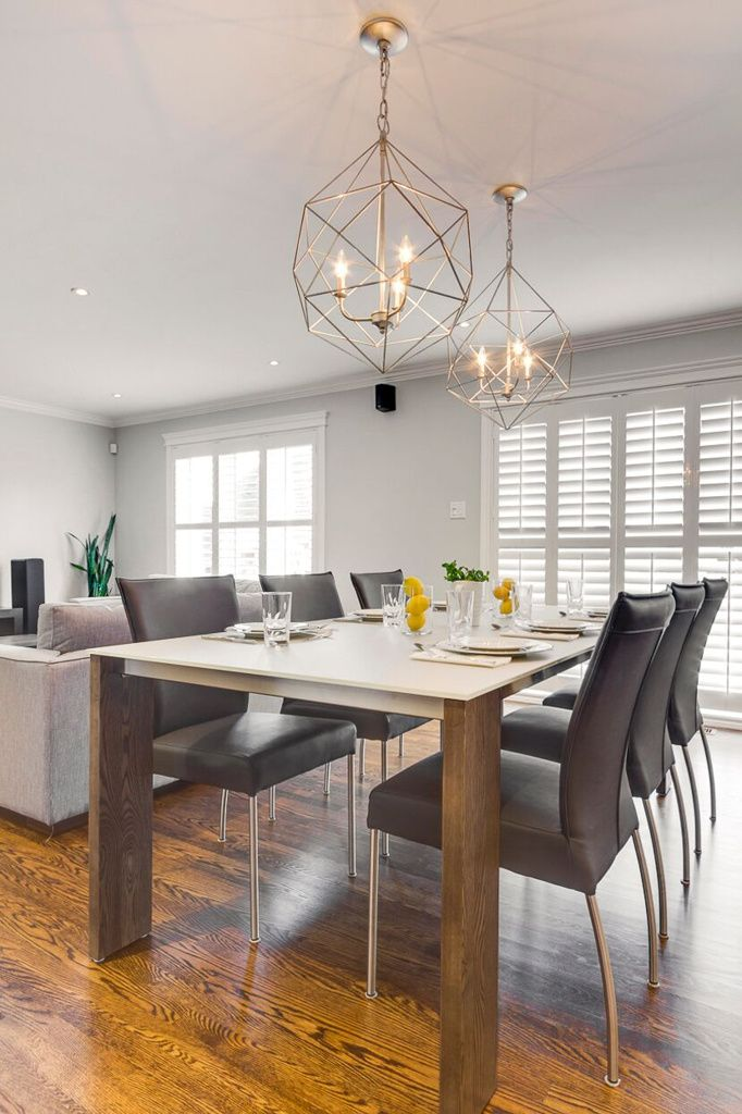 Modern Dining Room Design With Silver Caged Hanging Light Fixtures | Hibou  Design Co