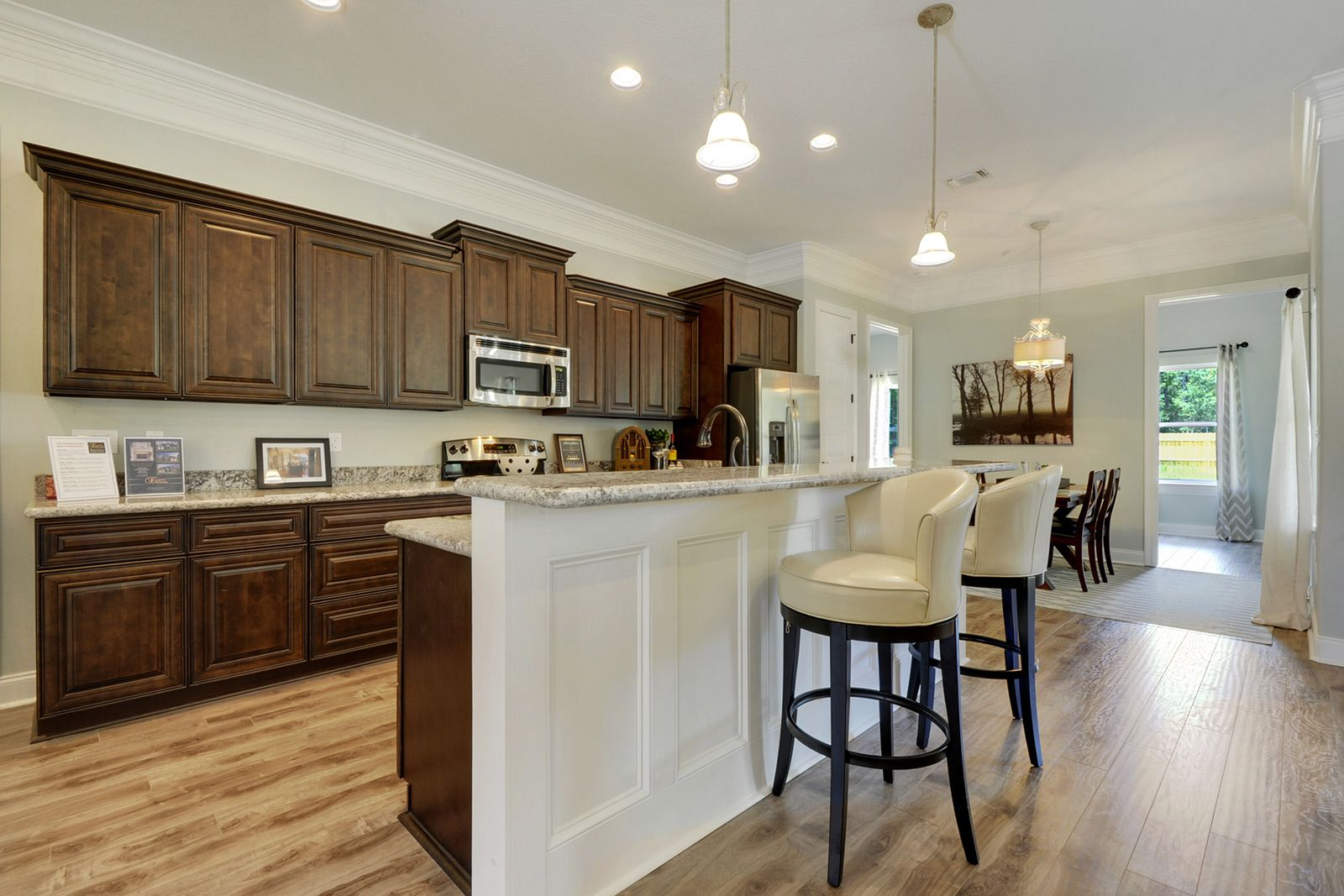 Large galley kitchen with chocolate cabinets and wainscoting on the ...