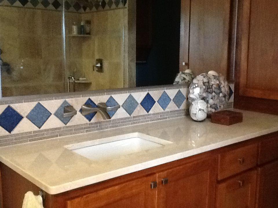 Crema Marfil Countertop With A Beautiful Backsplash Using Sonoma