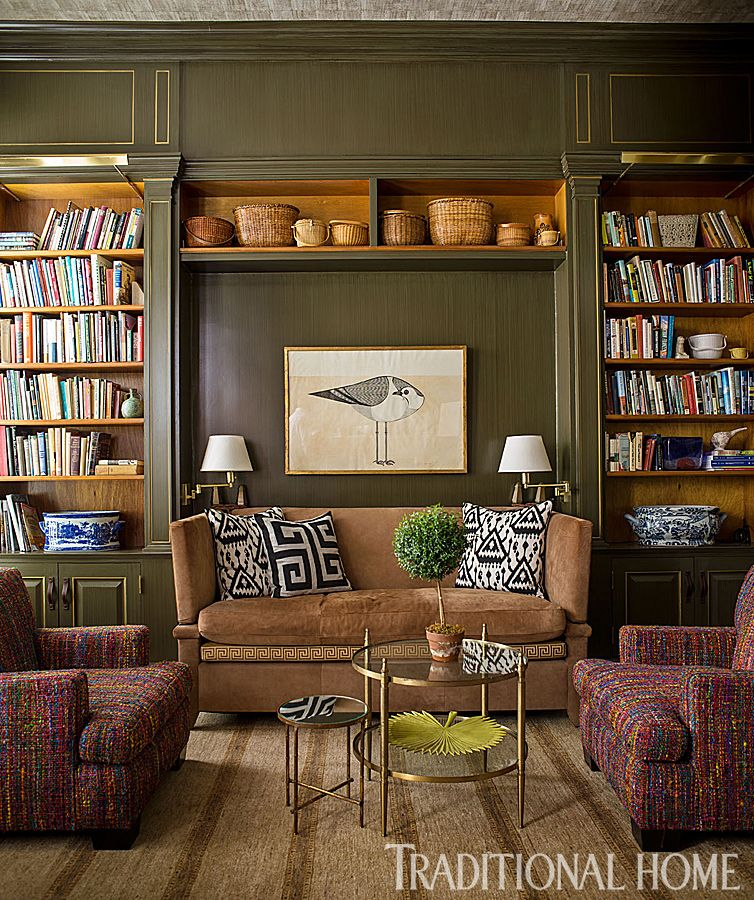 Olive green adorns the walls in the library where built