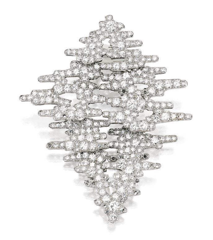 Andrew Grima c1965. Diamond Pendant-Brooch set in 18 Karat White Gold. Fitted with pendant loop. (Sotheby's)