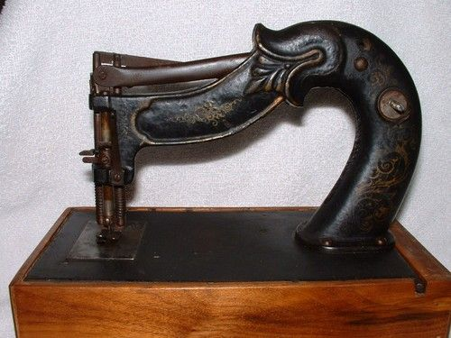 """1860's, rare Civil War era cast iron sewing machine. retains almost all of it's original black paint.& hand painted gold design with red flowers on the base. 2 patent dates, - Feb. 12, 1861 & April 8, 1862. The serial number on the underside of the machine arm and the mechanism underneath the base reads #9730. 8"""" long x 5"""" high. The base is 8 3/4"""" x 5""""."""